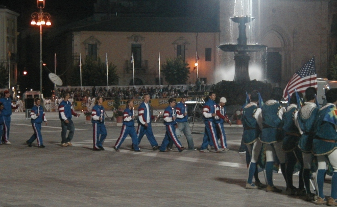 Team USA passing the fountain in Piazza Garibaldi.