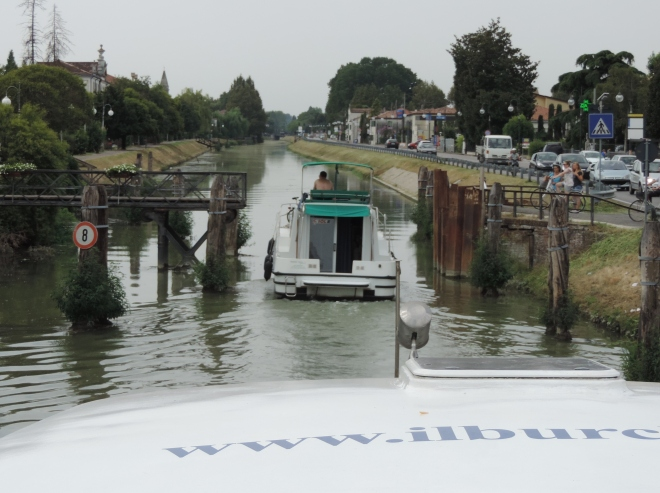 Cruising past an open bridge on the Brenta Canal.