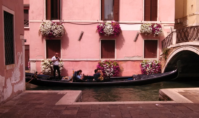 Gondolier with cell phone.