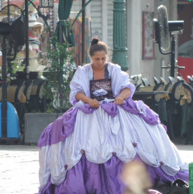 In the record breaking heat last August this girl dressed in her finery to entertain tourists along the waterfront.