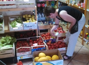 Tomato shopping in an Italian grocery store.