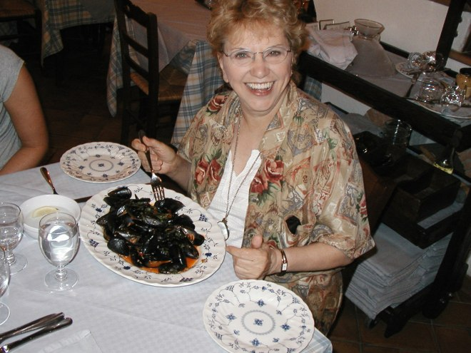 My mom, Win Perman, enjoying some steamed mussels in Sorrento ten years ago.