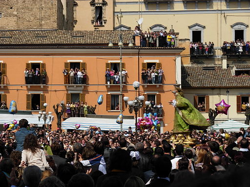 Residents crowd the balconies in Sulmona to watch the Madonna run through the streets.